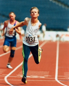 Australian athletics sprinter Tim Matthews at the finish line at the Atlanta 1996 Paralympic Games